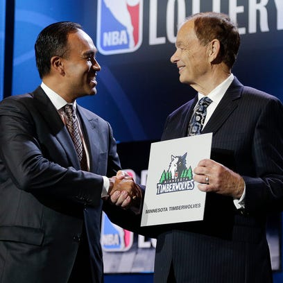 NBA Deputy Commissioner Mark Tatum, left, congratulates Minnesota Timberwolves owner Glen Taylor after the Timberwolves won the first pick in the draft, during the NBA basekball draft lottery, Tuesday, May 19, 2015, in New York. (AP Photo/Julie Jacobson)