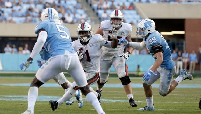 Virginia's Jordan Ellis (1) runs against North Carolina during the second half an NCAA college football game in Chapel Hill, N.C., Saturday, Oct. 14, 2017. Virginia won 20-14. (AP Photo/Gerry Broome)