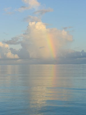 A rainbow graced the horizon at sunrise in East Hagatna on Thursday, June 30.