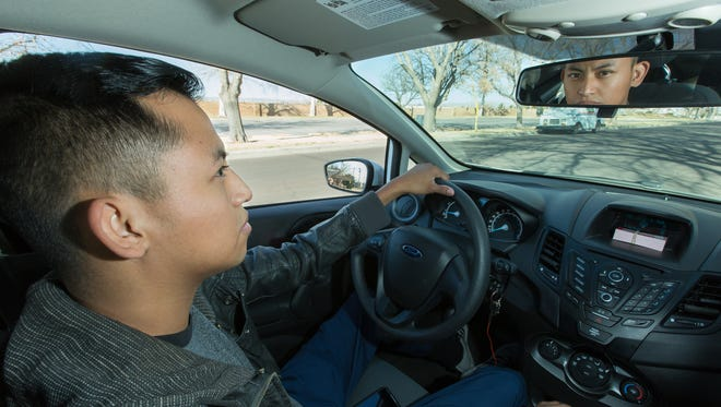 Carlos Morales, is pictured in his car. Morales is a driver for both Uber and Lyft in Las Cruces, New Mexico