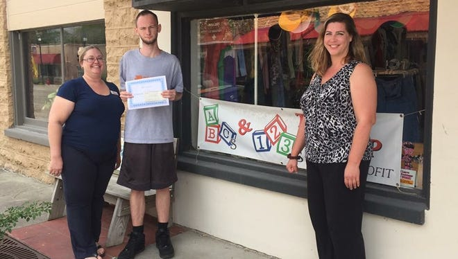 """Chris White, a volunteer at the ABC's and 123's store in Flippin, is the recipient of the group's first scholarship award. White is a student at ASU-Mountain Home. """"We are all so very proud of Chris and his dedication to ABC's and 123's,"""" said Cristin Jackson. Located on Main Street in Flippin,ABC's & 123's assists children and adults in the Twin Lakes Area with clothing needs and other assistance when available. The store is open from 10 a.m. to 4 p.m., Mondays through Fridays, and the first Saturday of each month. For information about ABC's and 123's, call the store at (870) 453-4000, Telicia Perry at 404-7438,Cristin Jackson at 405-8724 or contact your local school counselor."""