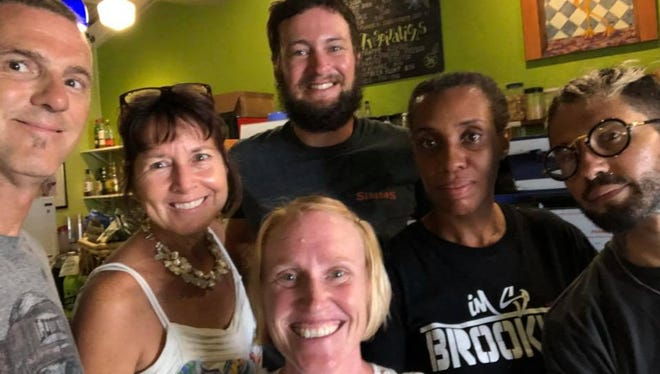 The staff of Polly's at the Pier in Frederiksted on St. Croix are learning to operate in a new normal. Pictured are Chuck Brittain, Sue Bacallao, Sean Moon, Margi Erway, Rebecca Lewis and Kanae Anderson.