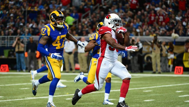 Arizona Cardinals running back Kerwynn Williams (33) runs past St. Louis Rams cornerback Marcus Roberson (47) for a 35 yard touchdown during the second half at the Edward Jones Dome.