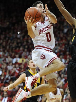 Indiana forward Will Sheehey drives to the basket for a lay up against Iowa inside Assembly Hall, Thursday, February 27, 2014, in Bloomington.