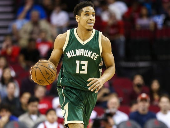 Milwaukee Bucks guard Malcolm Brogdon (13) brings the