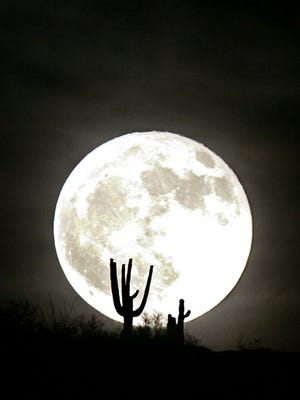 A full moon rises over Phoenix in June 2007.