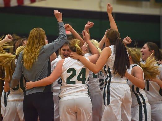 James Buchanan's girls basketball team does a group