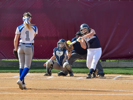 Chambersburg's Maggie Myers swings her bat in the first