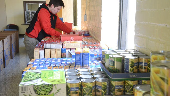 Chancelor Gillem, 15, organizes food which was distributed over the weekend to families for Easter.