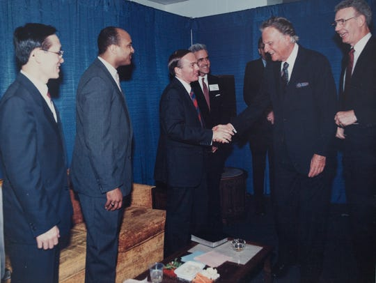 Ron Hutchcraft, center, a non-denominational Protestant