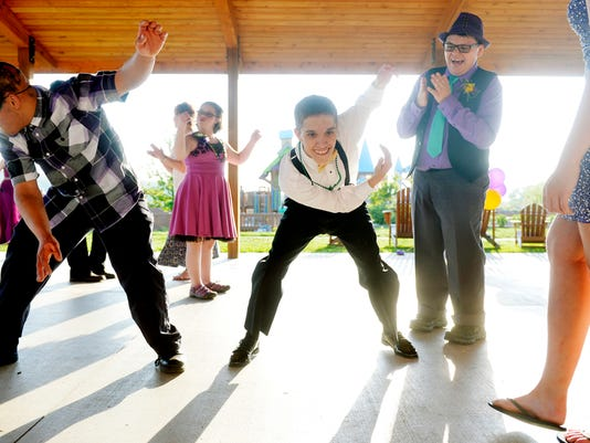 LIU students Jose Waltz, 18, Sebastian Joynes, 19 and Logan Walsh, 18, dance at a prom for Lincoln Intermediate Unit students on Friday. Schools across York and Adams counties are already working to find new locations for next year's prom, especially in light of the fact that the caterer for the Valencia Ballroom - a popular choice - is gone.