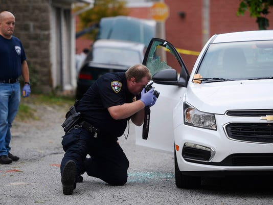 """York City police investigate at the scene of a fatal shooting on Grant Street near Jefferson Ave in York early Sunday, September 20, 2015. Kate Penn â """" Daily Record/Sunday News"""