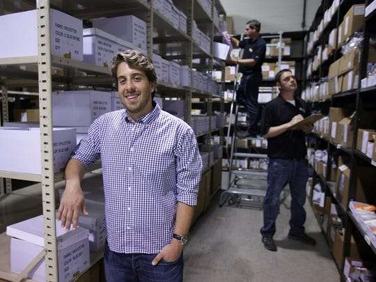 Steven Mazur goes over inventory for his new start-up company, Ash and Anvil, at FulEx Logistics, an ecommerce fulfillment center  in Warren, Mich., on Friday, Sept. 18, 2015. Ash and Anvil will provide dress-casual apparel for short men who have trouble buying clothes off the rack.