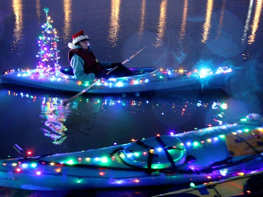 Karen Kraven of Salem paddles at last year's Illuminata Regatta.