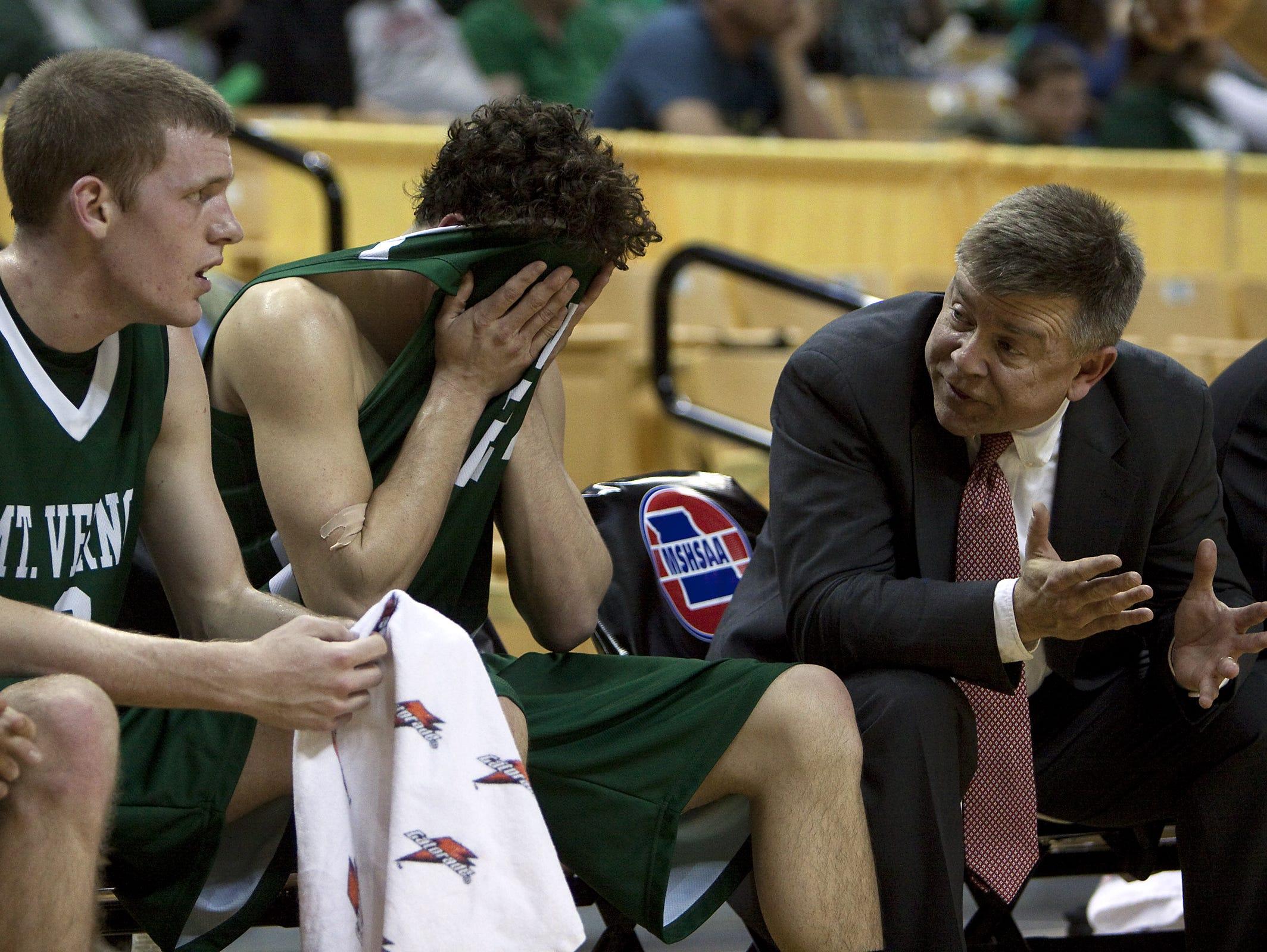 Skip Brock, right, spent 19 seasons coaching boys basketball at Mt. Vernon High School.
