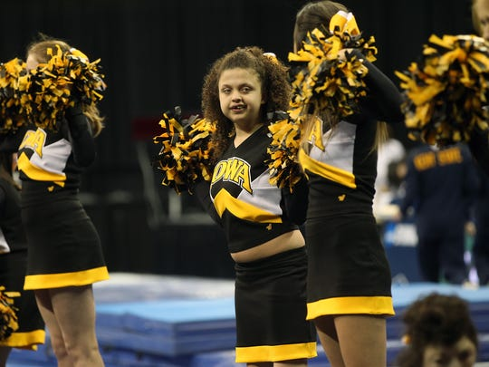 Madison Shults performs with the Hawkeye Sparkles at
