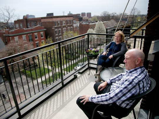 Dan Burbulla, 55, of Detroit, and his wife Laura Wood, 57, of Detroit, sit in the balcony of their new condo in the Willys Loft on Tuesday, April 19, 2016 in Detroit, MI