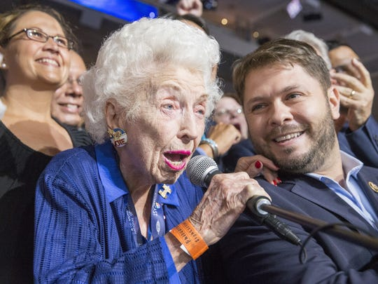 Jerry Emmett, the 102-year-old honorary chair of the Arizona Democratic delegation, helps report Arizona's delegate votes for Hillary Clinton during a historic Roll Call of States at the Democratic National Convention on July 26, 2016.