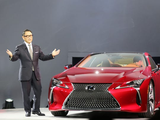 Toyota's president Akio Toyoda introduces the  2017 Lexus LC500 Sport Coupe during the 2016 North American International Auto Show held at Cobo Center in downtown Detroit on Monday, Jan. 11, 2016.