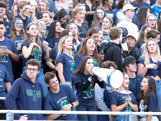 Damonte Ranch fans cheer at Friday's game at Damonte.