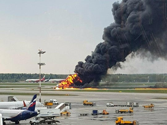 Video of the landing showed flames and smoke billowing from the rear of the plane.