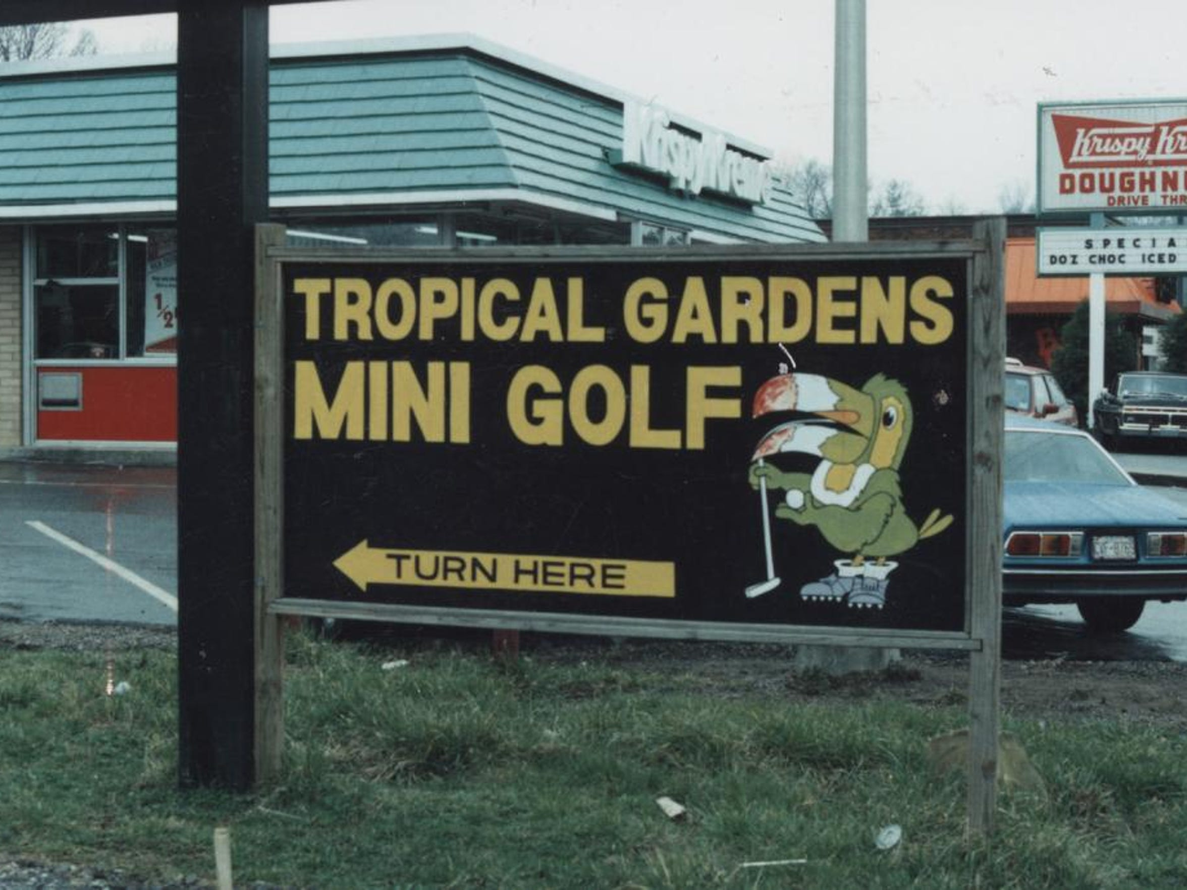 The original sign outside of Tropical Gardens Mini