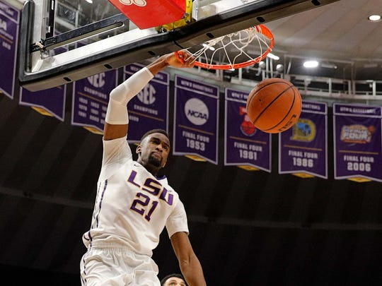 LSU Tigers forward Aaron Epps (21) dunks the ball in