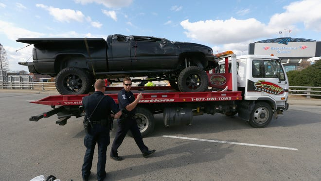 A pickup truck belonging to quarterback Cam Newton of the Carolina Panthers, that was involved in a roll over accident, is towed away from in front of Bank of America Stadium on December 9, 2014 in Charlotte, N.C.