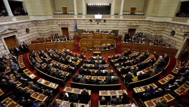 Greece's lawmakers attend the second round of voting to elect a new Greek president at the Parliament in Athens on Tuesday, Dec. 23, 2014.