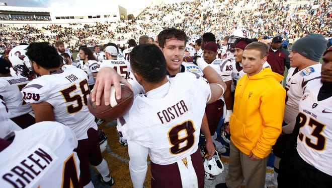 Arizona State quarterback Taylor Kelly and D.J. Foster hug after their victory over Duke on Saturday, Dec. 27, 2014 at the Sun Bowl in El Paso.