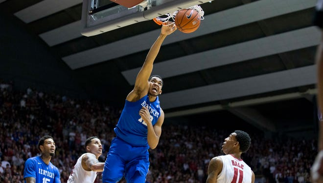 Kentucky forward Karl-Anthony Towns (12) dunks as Alabama's Michael Kessen, second from left, and Shannon Hale (10) look on during the first half of an NCAA college basketball game, Saturday, Jan. 17, 2015, in Tuscaloosa, Ala. (AP Photo/Brynn Anderson)