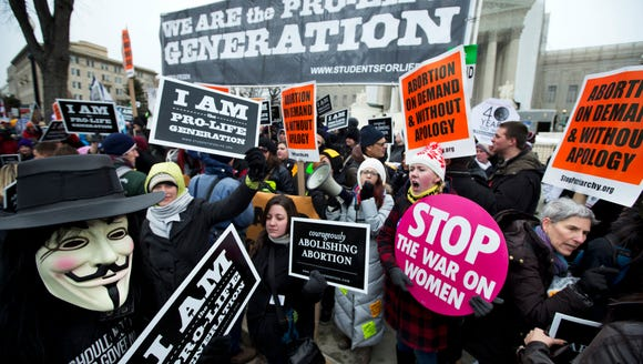 Abortion rights demonstrators gather at the Supreme