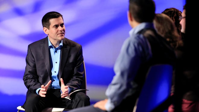 In this Oct. 28, 2014 file photo, Rev. Russell Moore, left, director of the Southern Baptist's Ethics and Religious Liberty Commission, leads a discussion during the group's national conference in Nashville, Tenn.  Moore is one of several white leaders calling for multiethnic congregations in the wake of the unrest spurred by the killings of black men by white police officers in Ferguson, Missouri, and New York City.