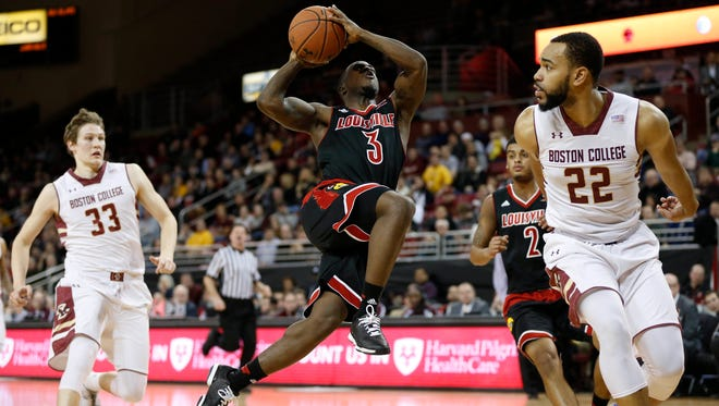 Jan 28, 2015; Chestnut Hill, MA, USA;  Louisville Cardinals guard Chris Jones (3) drives to the basket while defended by  Boston College Eagles guard Aaron Brown (22) and guard Patrick Heckmann (33) during the first half at Silvio O. Conte Forum. Mandatory Credit: Greg M. Cooper-USA TODAY Sports