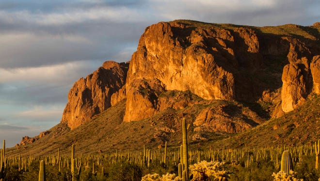 The sun sets over the Superstition Mountains, Saturday, October 18th, 2014 in Apache Junction, Ariz.