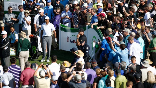 Jan 28, 2015: Spectators watch Tiger Woods on the par-4 11th hole at the Annexus Pro-Am at the Waste Management Phoenix Open at TPC Scottsdale.