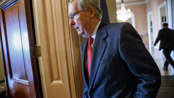 """Senate Majority Leader Mitch McConnell of Ky.walks to his office from the Senate chamber on Capitol Hill in Washington, Thursday, Jan. 8, 2015, after making plans to begin debate on the Keystone XL pipeline bill which cleared the Senate Energy and Natural Resources Committee earlier. The pipeline bill, the first piece of legislation in the Republican-controlled Senate, is on a collision course with the White House, and neither side appeared to be giving any ground Thursday. McConnell called on Obama to rescind his veto threat Thursday and, in a statement, said """"So for a president who has said he'd like to see more bipartisan cooperation, this is a perfect opportunity."""" (AP Photo/J. Scott Applewhite)"""