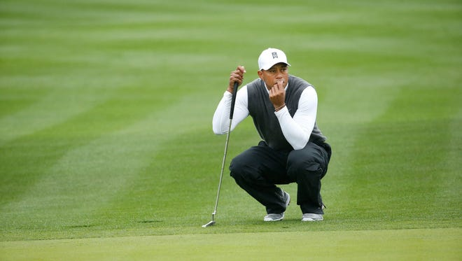 Tiger Woods waits to putt on the 9th hole during the second round of the Waste Management Phoenix Open at TPC Scottsdale in Scottsdale on Jan. 30.