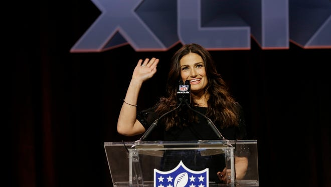 Idina Menzel answers questions at a pregame news conference for NFL Super Bowl XLIX football game Thursday, Jan. 29, 2015, in Phoenix. Menzel is scheduled to sing the national anthem.