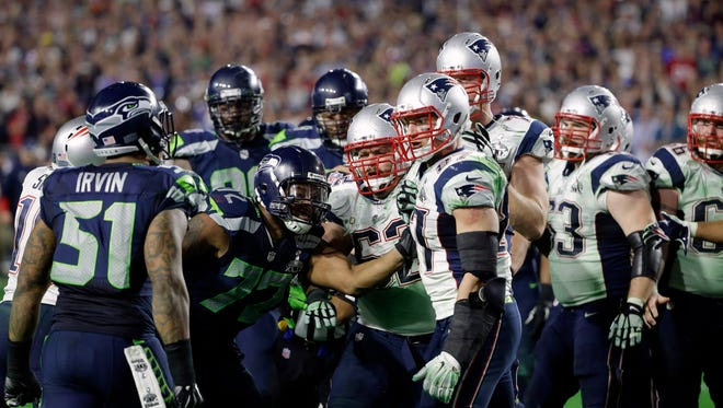 Seattle Seahawks outside linebacker Bruce Irvin (51), far left, gets into a brawl at the end of the second half of NFL Super Bowl XLIX football game against the New England Patriots on Sunday, Feb. 1, 2015, in Glendale, Ariz. (AP Photo/Matt Rourke)