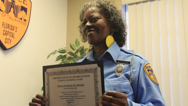 Rosa Pledge-Flowers holds up her certificate for her hard work as a crossing guard. Pledge-Flowers has worked as a crossing guard for 27 years. TPD honored 39 crossing guards for their hard work as part of Florida School Crossing Guard Appreciation Day on Friday.