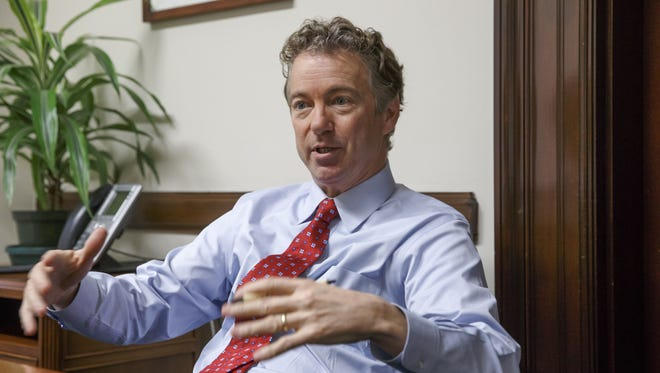 In this photo taken Feb. 10, 2015, Sen. Rand Paul, R-Ky. speaks in his office on Capitol Hill in Washington.  Paul said he is likely to announce whether he'll run for president in 2016 sometime in March or April from his home state of Kentucky. The Kentucky Republican told reporters after a Friday speech in Louisville that he was getting closer to making a decision, but all signs point to Paul launching a campaign. Next month, he will ask the state Republican Party to create a presidential caucus in 2016. That way, Paul could run for president and re-election to his Senate seat simultaneously without appearing on the primary ballot for two offices. That's banned by Kentucky law.