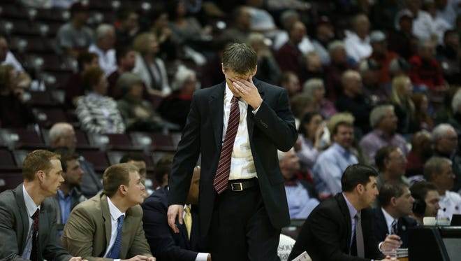 Missouri State Bears head coach Paul Lusk walks dejected during the second half of the Bears' senior night game played at JQH Arena in Springfield, Mo. on Feb. 25, 2015.
