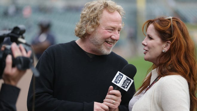 Actor Timothy Busfield interviews his wife Melissa Gilbert as they are filmed by a Detroit Tigers videographer before the start of a baseball game in Detroit, Friday, May 10, 2013.