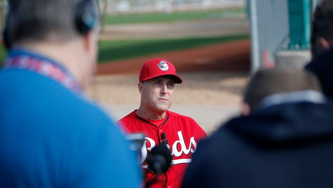 Reds manager Bryan Price talks to the media during spring training.