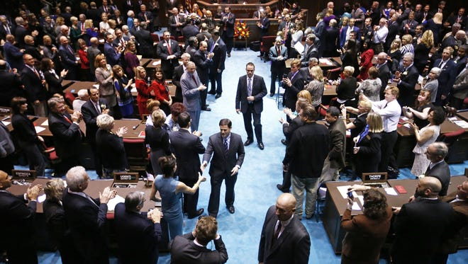 Governor Doug Ducey greets Rep. Michelle Ugenti (District 8 ) after delivering his State of the State address in the Arizona House of Representatives during opening day of the 52nd Legislature on Monday, Jan. 12, 2015 in Phoenix, AZ.