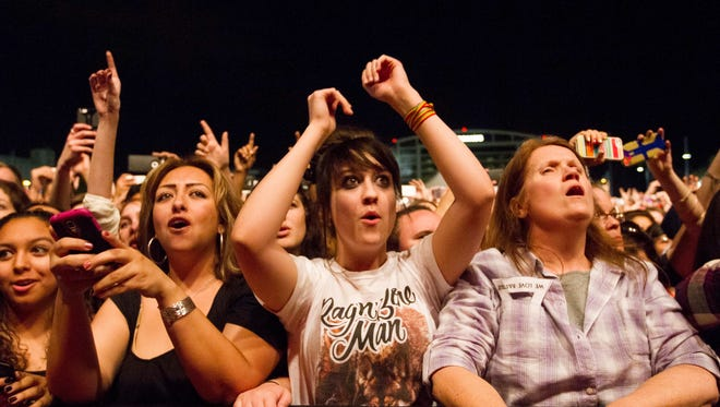 Fans cheer as Bastille performs on Stage 1 as the headliner during the Pot of Gold Music Festival at Tempe Beach Park, Friday, March 13th, 2015, in Tempe Ariz.