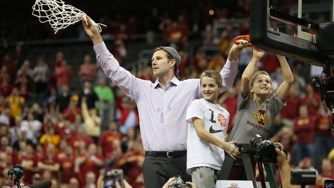 Iowa State head coach Fred Hoiberg cuts down the net with his two son after the Big 12 Championship title game on Saturday.