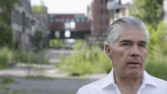 In a Friday, June 27, 2014 photo, Packard Plant owner Fernando Palazuelo tours the industrial site in Detroit.