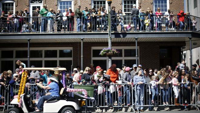 Spectators fill the sidewalks and balconies over Monroe Street to watch the Springtime Tallahassee parade downtown on Saturday.